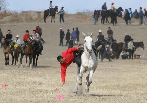 Grab the coin - nomad horse games - photo provided by Travel Experts, Kyrgyzstan to Writers' Expeditions