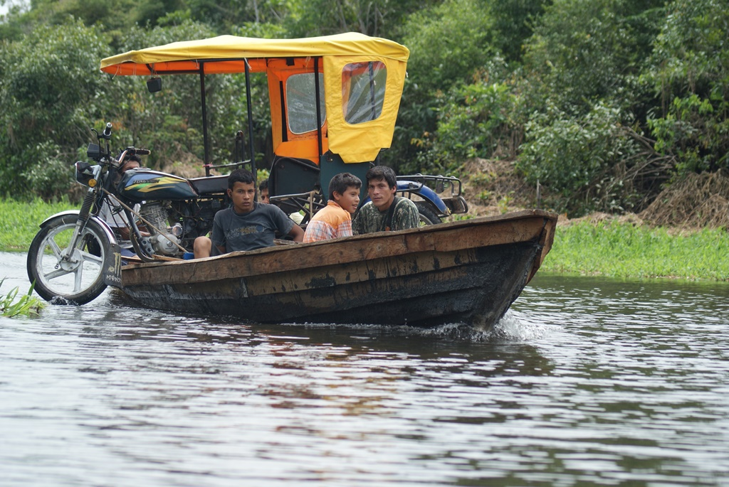 moto taxi on boat, Amazon, photo by Kirsten Koza (Writers' Expeditions)