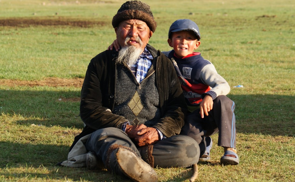 Nomad grandfather and grandson spend their summers with their herds. (photo by Kirsten Koza)