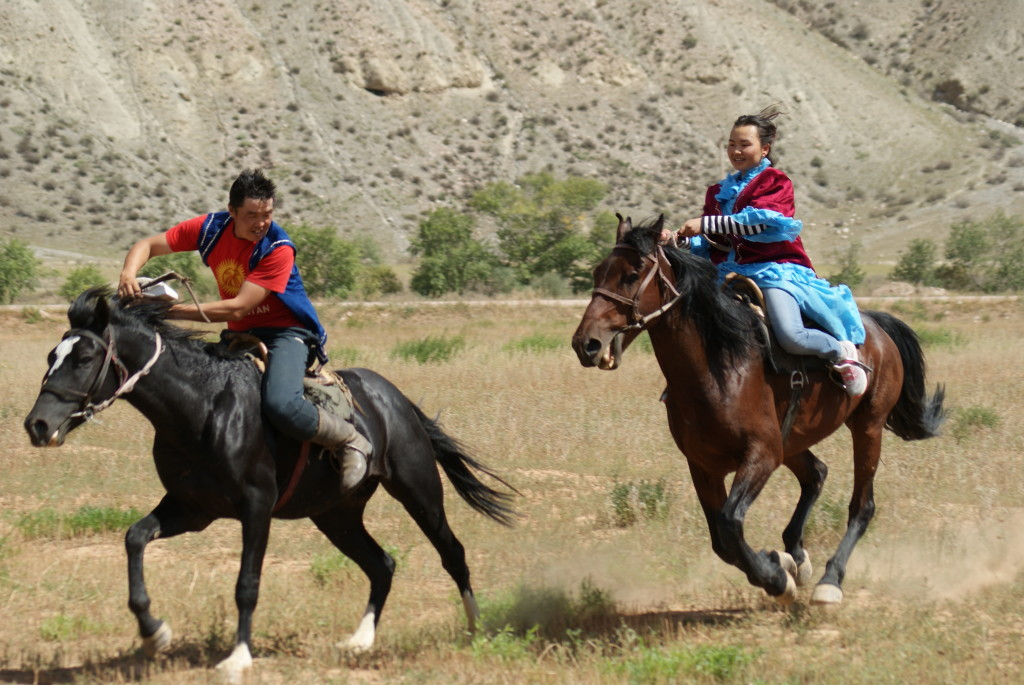 "My translator Janarkul, right, was asked to compete in the Capture or ""Kiss the Girl"" Competition at the Nomads' Horse Games. (photo by Kirsten Koza)"