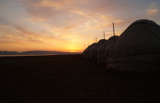 Kyrgyzstan sunrise over yurts (photo by Kirsten Koza)