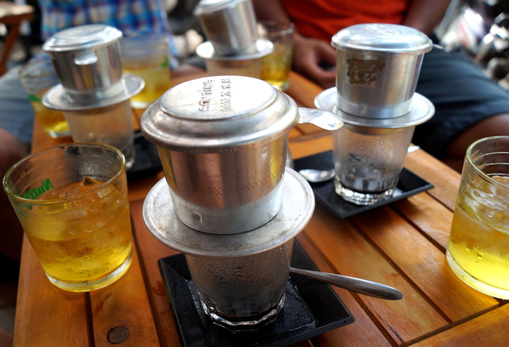 Vietnamese coffee often comes with a complimentary cup of tea. (Photo by Kirsten Koza, Writers' Expeditions)