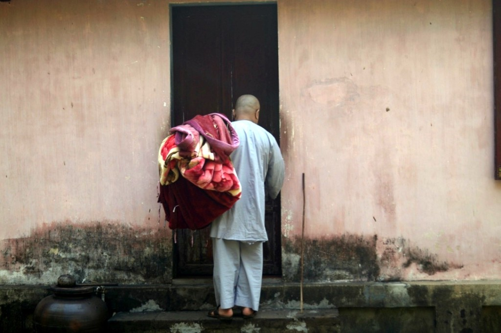 Monk at side entrance, at Thien Mu Pagoda, Hue. (Photo by Kirsten Koza,  Writers' Expeditions)