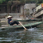 Tam Coc, camera woman in sampan boat (Photo by Kirsten Koza, Writers' Expeditions)