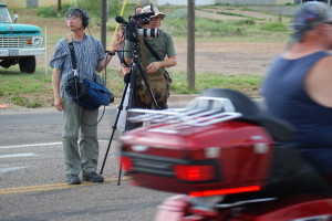 Camerman and soundman from Hong Kong dodge traffic on Route 66. (Photo by Kirsten Koza)