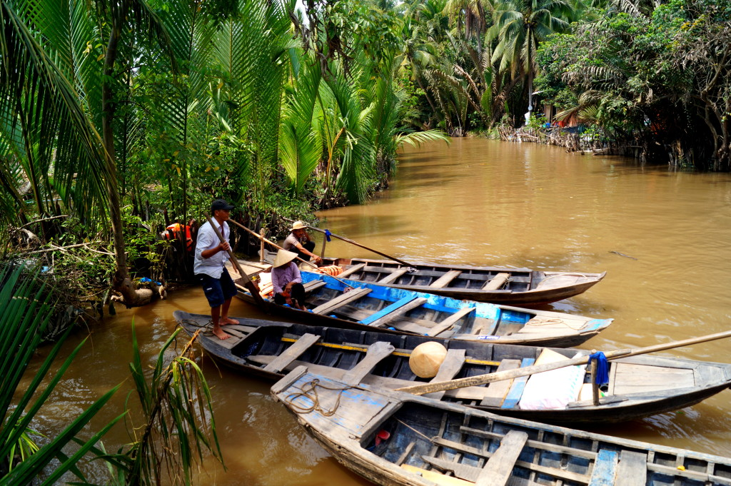 Mekong Delta, locals with sampan boats. (Photo by Kirsten Koza)