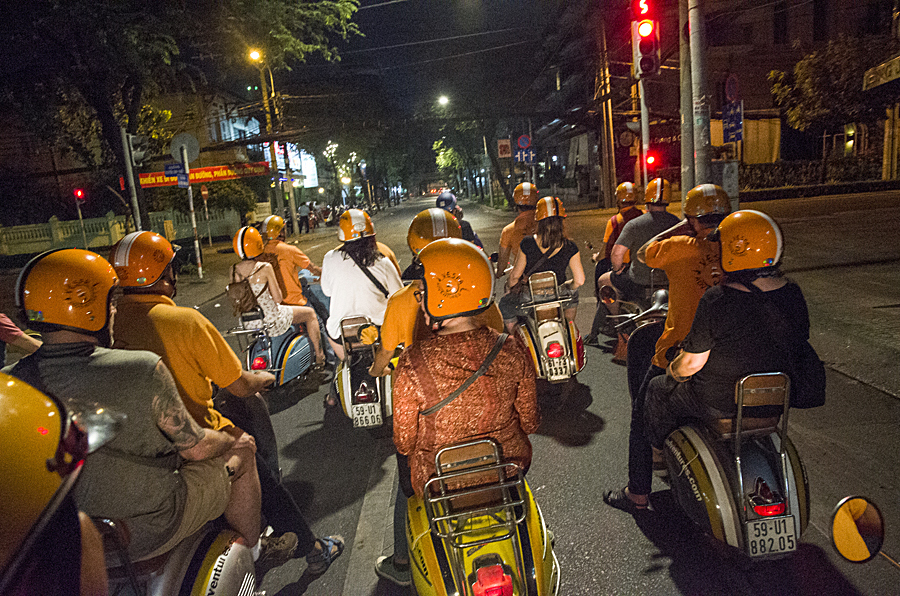 Vintage Vespa food and nightlife tour in Saigon (Photo by Writers' Expeditions photography host, Christopher Campbell)
