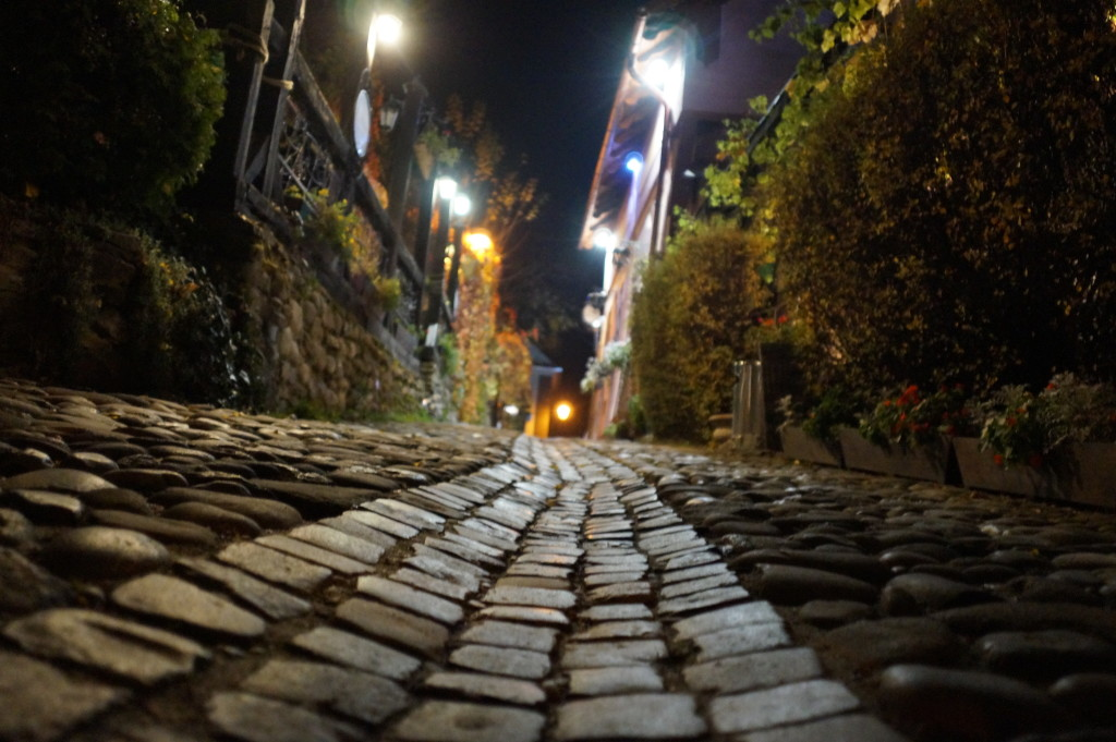 Night shot on the cobbled medieval streets of Sighisoara, Romania. (Photo by Kirsten Koza, travel author and host of the Vlad Dracula Expedition)