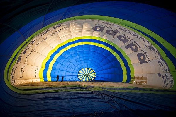 Inside the massive hot air balloon as it fills. (Photo by Christopher Campbell, Writers' Expeditions)