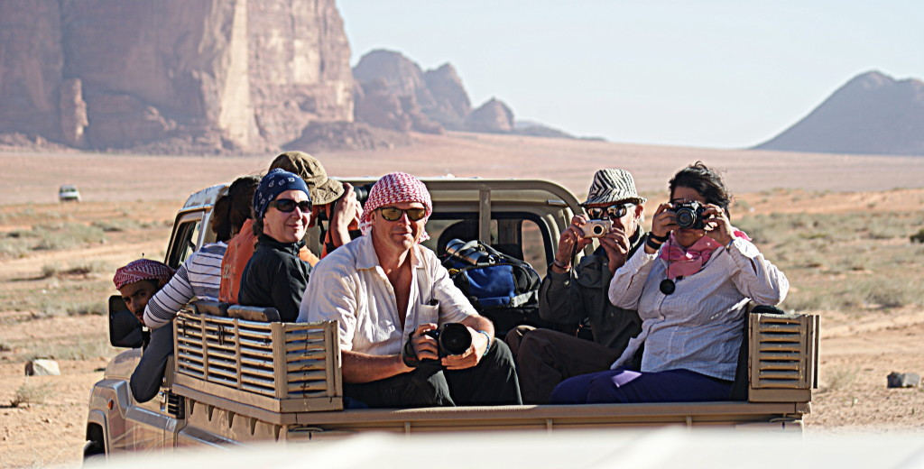 This is how we'll roll in Wadi Rum. That's Salem, our Bedouin host leaning out of his truck window. And that's Chris, your photography host, wearing his red and white keffiyeh in the back. (Photo taken by Kirsten Koza, your expedition host, standing in the back of another truck.)