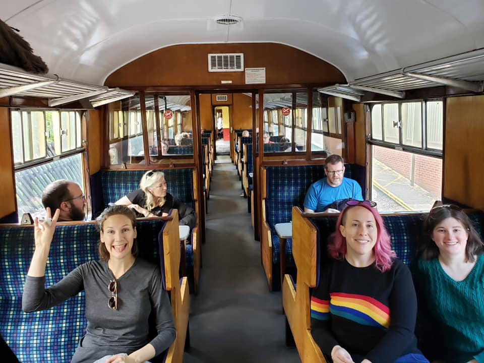 2019's Decency Be Damned participants on the steam train. (photo by Kirsten Koza)