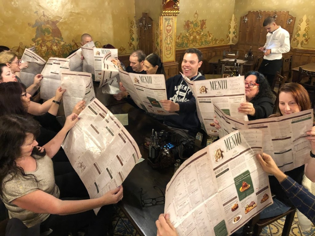 2019's Vlad Dracula Expedition participants peruse the menus at The Beer Chariot. (Photo by Christopher Campbell)